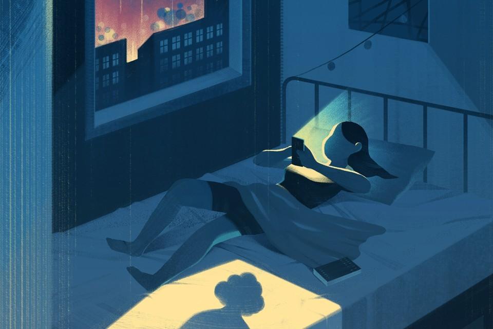 GIrl on phone in bed.jpg